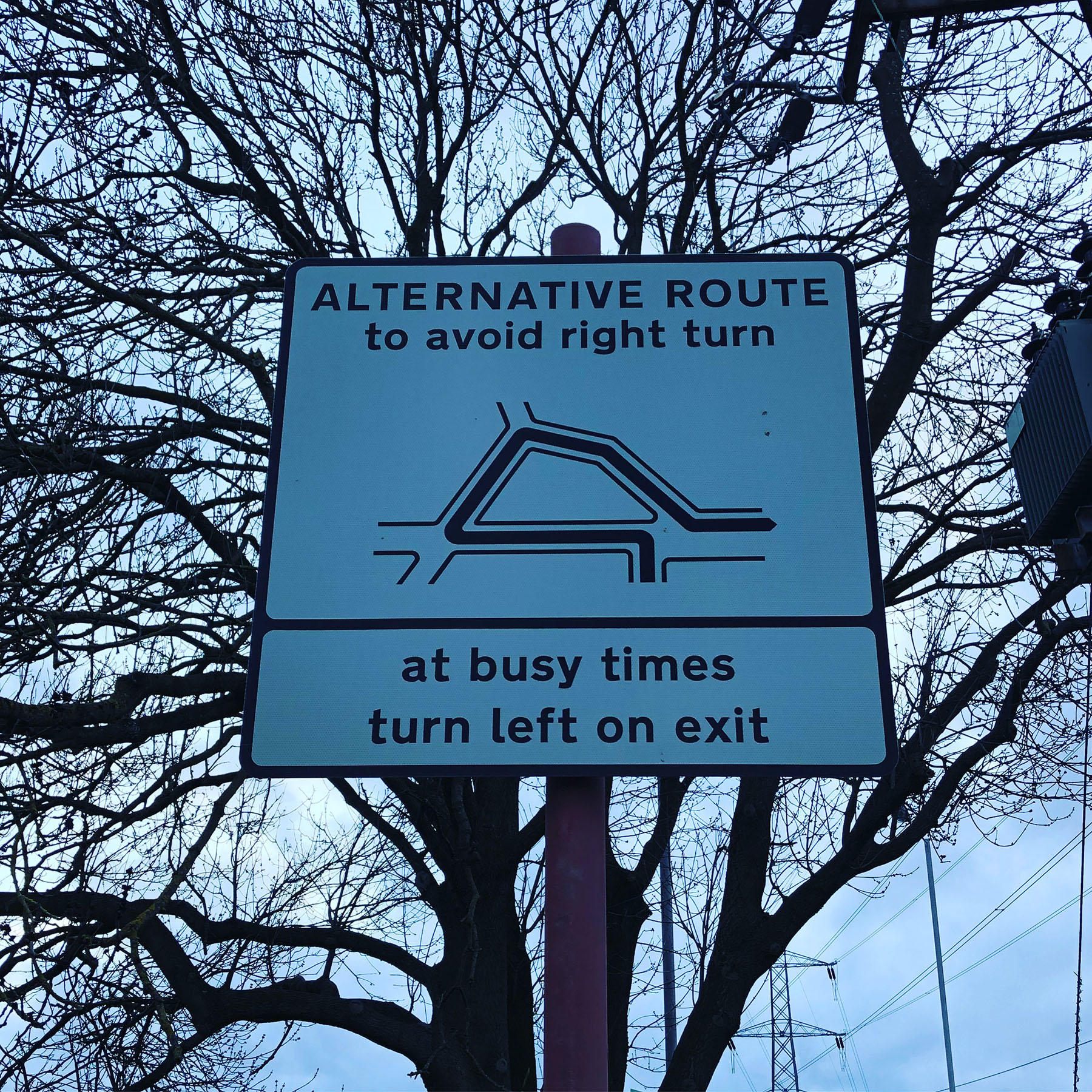 The sign giving instructions how to turn out onto Harrogate Road