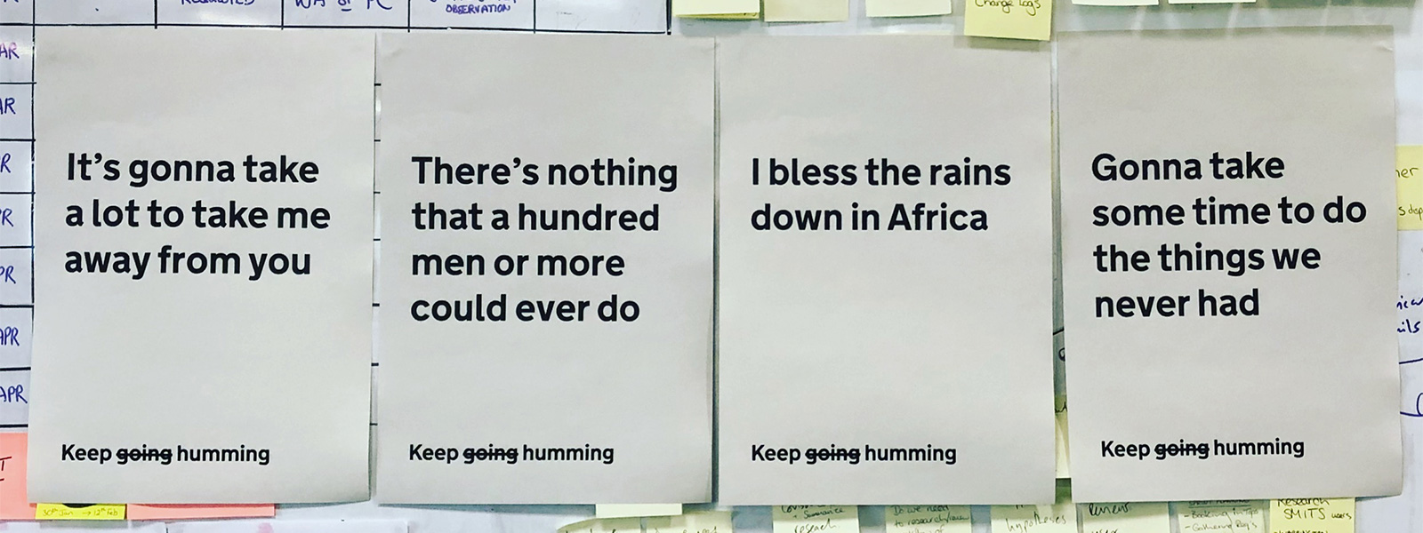 The chorus of Africa printed, line by line, onto posters we have hung up in our office