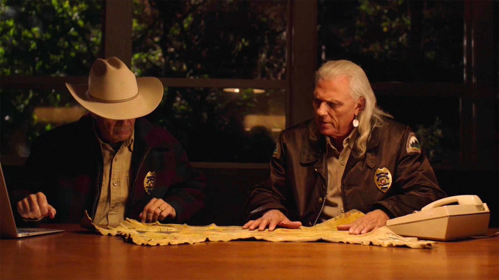 Screen grab from Twin Peaks showing Hawk and Truman looking at a map